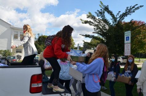 Members of the freshmen class prepare donations on a sisterhood experience day.